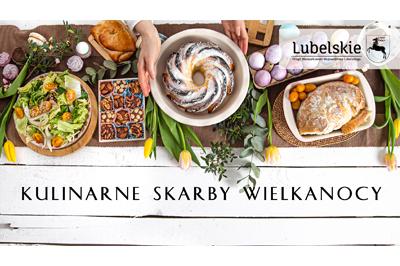"""Na zdjęciu (ujęcie z lotu ptaka) stół zastawiony różnymi produktami żywnościowymi (babka, jajka chleb), stół przyozdobiony tulipanami i gałązkami z liścmi. Na dole napis wersalikami """"Kulinarne Skarby Wielkanocy"""", w górnym prawy roku na lekko przeźroczystej białej apli czarny logotyp """"Lubelskie Urząd Marszałkowski Województwa Lubelskiego"""""""